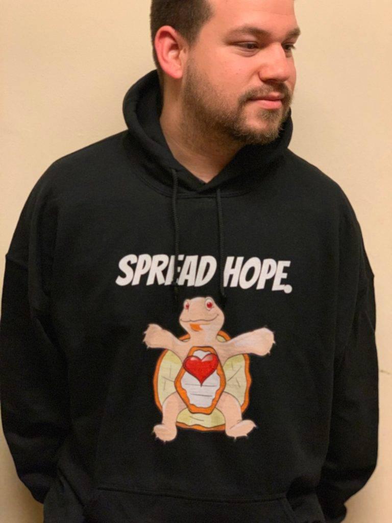 Mike wearing hope the turtle hoodie